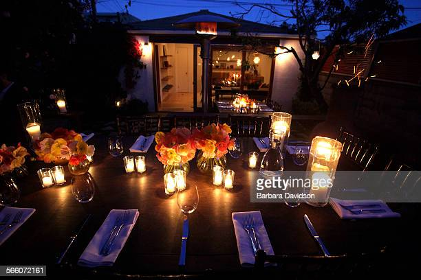 View of the dinner table looking over the backyard of Venice home owner Jennifer McGarigle May 22 2010 in Venice It's a hybrid story design and...