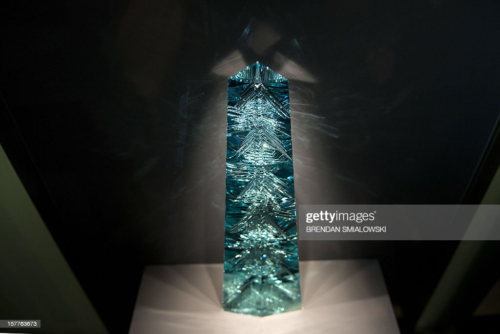 A view of the Dom Pedro after its unveiling in the Janet Annenberg Hooker Hall of Geology, Gems and Minerals at the Smithsonian's National Museum of Natural History December 6, 2012 in Washington, DC. The Dom Pedro aquamarine, currently considered the largest single piece of cut gem aquamarine in the world, was donated to the Smithsonian by Jane Mitchell and her husband Jeffrey Bland. AFP PHOTO/Brendan SMIALOWSKI