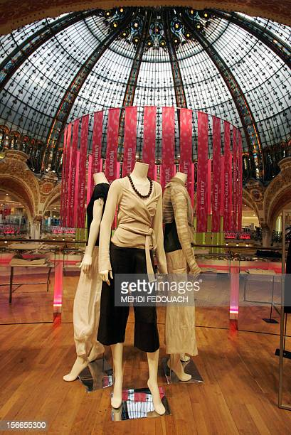 A view of the dome of the Haussman boulevard's Galeries Lafayette store 29 March 2005 in Paris French bank BNP Paribas and a founding family...
