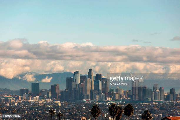 View of the downtown Los Angeles skyline with the snow-covered San Gabriel Mountains in the background on November 29, 2019 in Los Angeles,...