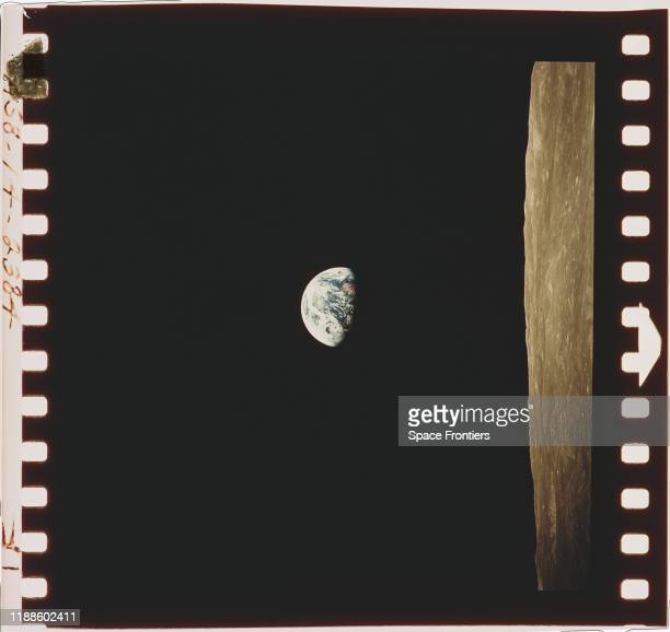 A view of the Earth beyond the lunar horizon taken from the Apollo 8 spacecraft while in orbit around the Moon by crewmember Bill Anders 24th...