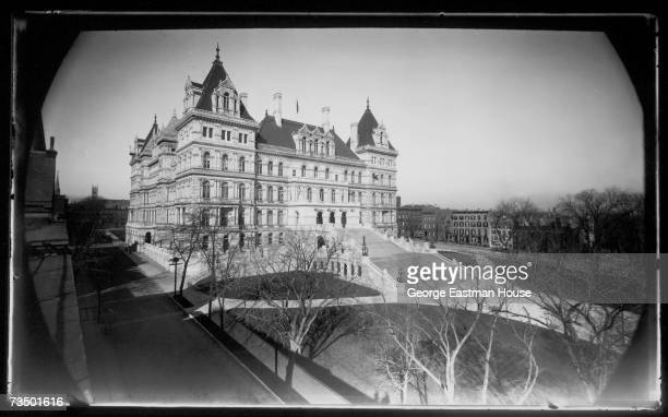 View of the east face of the New York State Capitol Building Albany New York mid 1900s The building was started in 1867 and completed %25 million and...
