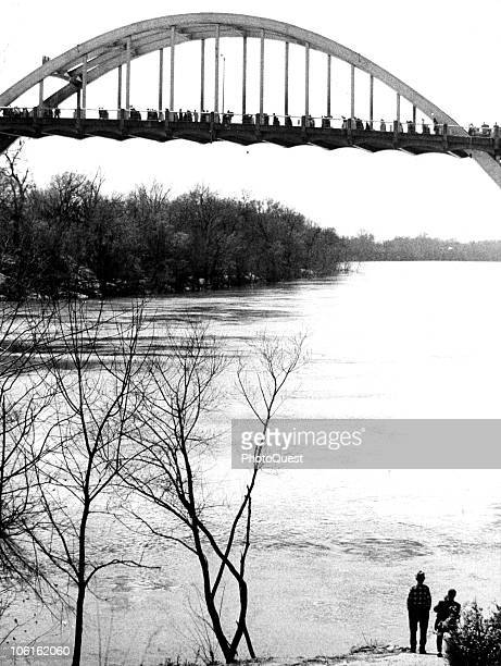 View of the Edmund Pettus Bridge across the Alabama river as it is crossed by thousands of Civil Rights demonstrators during the third Selma to...
