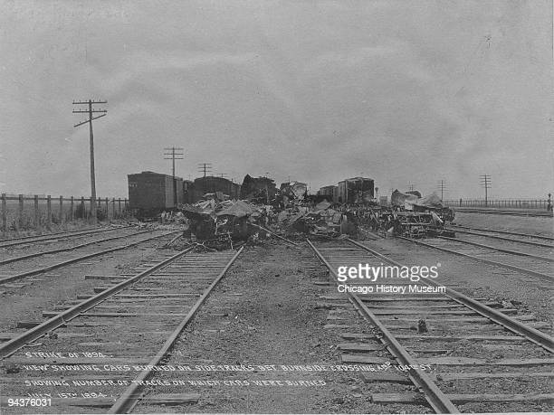 A view of the effects of the 1894 Pullman strike showing burned cars on sidetracks between Burnside Crossing and 104th street and showing the number...