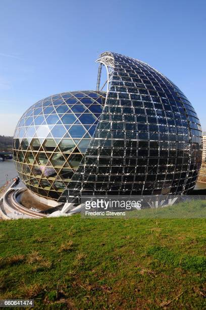 View of the egg or the nest that surrounds a huge veil of 45 meters high covered with 800 m2 of photovoltaic panels of La Seine Musicale which is...