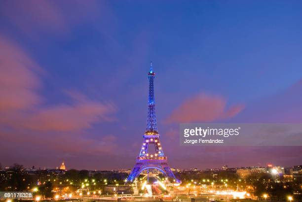 View of the Eiffel tower illuminated in blue displaying the European symbol due to the French presidency of the European Union