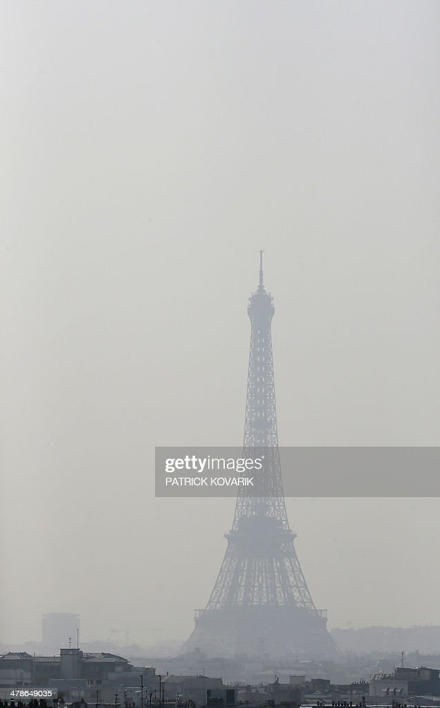 A view of the Eiffel Tower seen through thick smog, on March 14, 2014, in Paris. Fine particle pollution in several French cities continued unabated today as the modest measures taken by local authorities failed to solve the underlying problem. French non-governmental organization (NGO) Ecologie Sans Frontiere (Ecology without borders) confirmed on March 11 that they had filed a criminal complaint in Paris to denounce the 'health scandal' of air pollution, as several regions of France experienced high levels of particulate pollution.