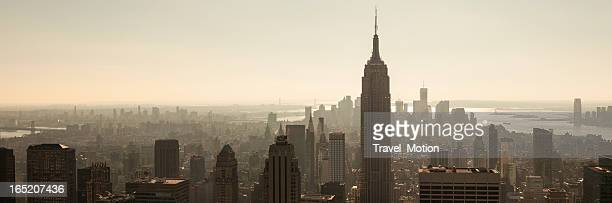 view of the empire state building and manhattan skyline - wide stock pictures, royalty-free photos & images
