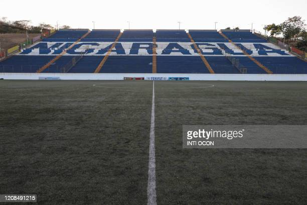 View of the empty National stadium before the local football match between Managua FC and Cacique Diriangen FC in Managua on March 28, 2020. - The...