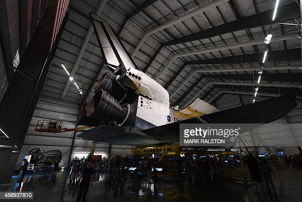 View of the engines as workers install the final payload a configuration similar to the STS118 mission consisting of a flown SPACEHAB into the Space...