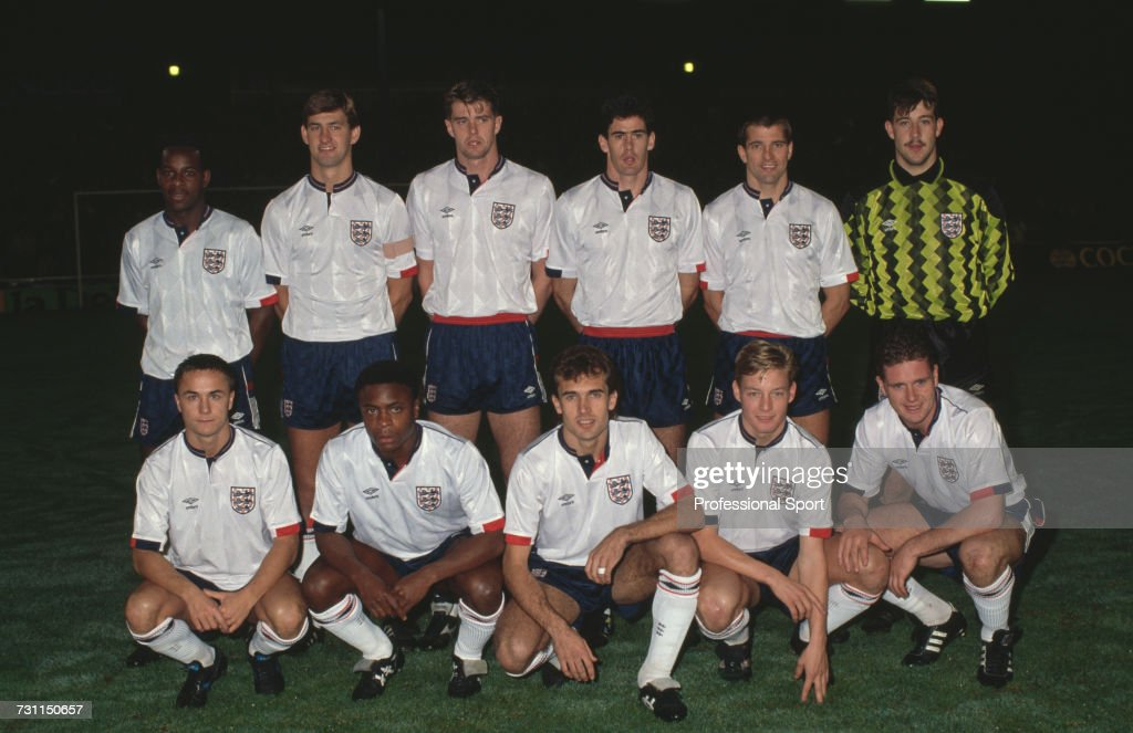 View of the England national football B team squad posed together prior to their friendly international match with Italy B at the Goldstone Ground in Brighton on 14th November 1989. The game would end in a 1-1 draw. The team B players are, back row from left to right: Michael Thomas, captain Tony Adams, Gary Pallister, Mike Newell, Steve Bull and Nigel Martyn. Front row from left to right, Dennis Wise, Paul Parker, Tony Dorigo, David Batty and Paul Gascoigne.