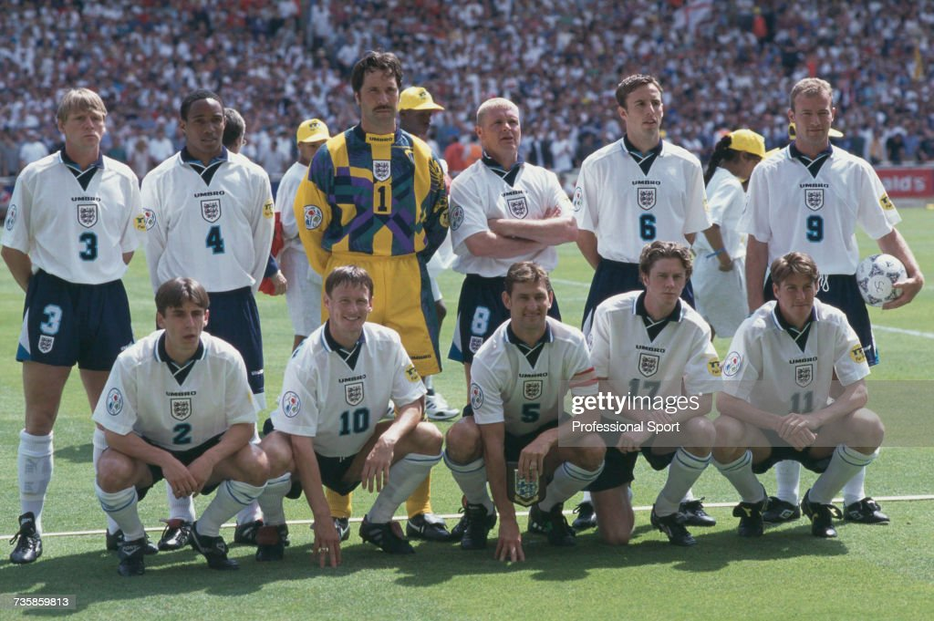 View of the England national football team squad pictured together on the pitch prior to the group A game between Scotland and England during the UEFA Euro 1996 European Football Championship at Wembley Stadium in London on 15th June 1996. England would go on to win the game 2-0. Back row from left to right: Stuart Pearce, Paul Ince, David Seaman, Paul Gascoigne, Gareth Southgate and Alan Shearer. Front row from left to right: Gary Neville, Teddy Sheringham, Tony Adams, Steve McManaman and Darren Anderton.