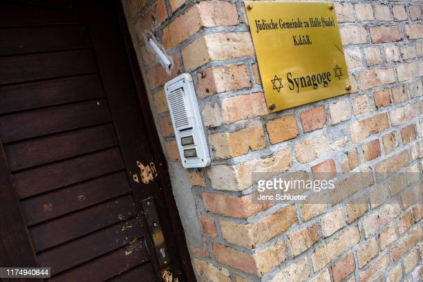 View of the entrance door to the Jewish synagogue with the bullet holes from yesterday's raid on October 10 2019 in Halle Germany Law enforcement...