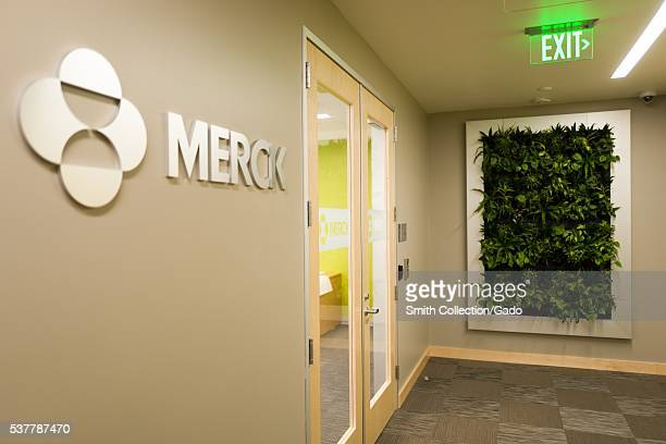 View of the entrance to the Mission Bay office of pharmaceutical company Merck including the Merck logo and a green wall featuring local plants 2016