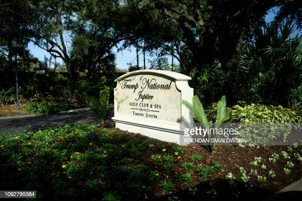 A view of the entrance to the Trump National Golf Club Jupiter as US President Donald Trump's motorcade arrives February 2 in Jupiter Florida