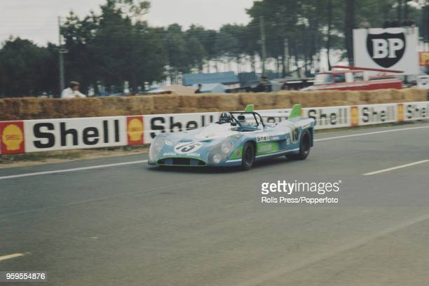 View of the Equipe MatraSimca Shell MatraSimca MS670 racing car driven by Henri Pescarolo of France and Graham Hill of Great Britain competing to...