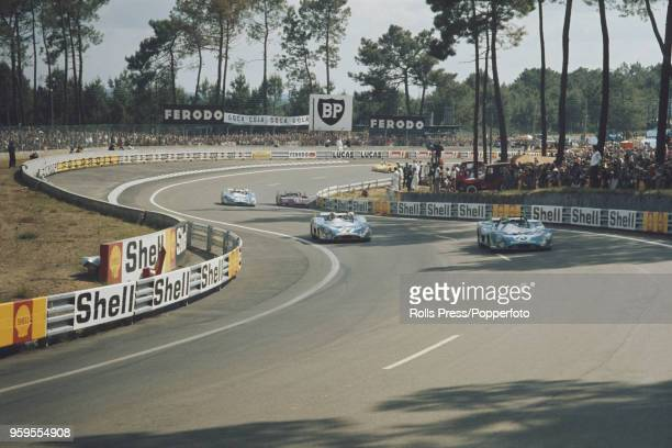 View of the Equipe MatraSimca Shell MatraSimca MS670 racing car driven by Henri Pescarolo of France and Graham Hill of Great Britain leading team...