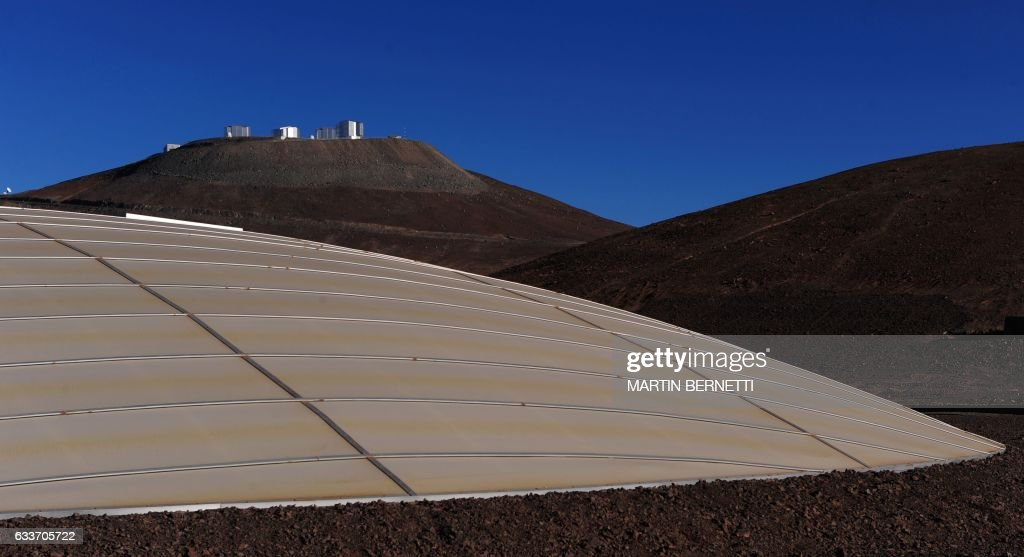 View of the European Southern Observatory (ESO) and the dome of the residence for its astronomers (foreground) on September 15, 2008 in Paranal, some 1150 km north of Santiago, Chile. Chile won the right April 26, 2010 to host the largest-ever telescope, the Munich-based European Southern Observatory (ESO) said, calling the planned facility 'the world's biggest eye in the sky'. The new observatory will be built atop the Armazones hill, near the ESO. AFP PHOTO/Martin Bernetti /