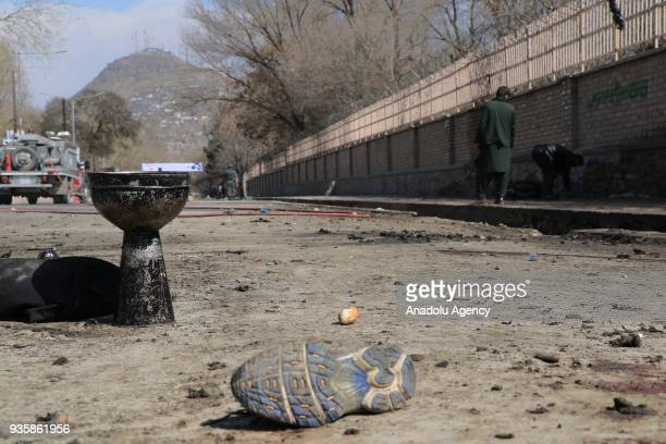 A view of the explosion site is seen after a suicide bomb blast that targeted a shrine visited by Shi'ite Muslims as the country observes the Nowruz...