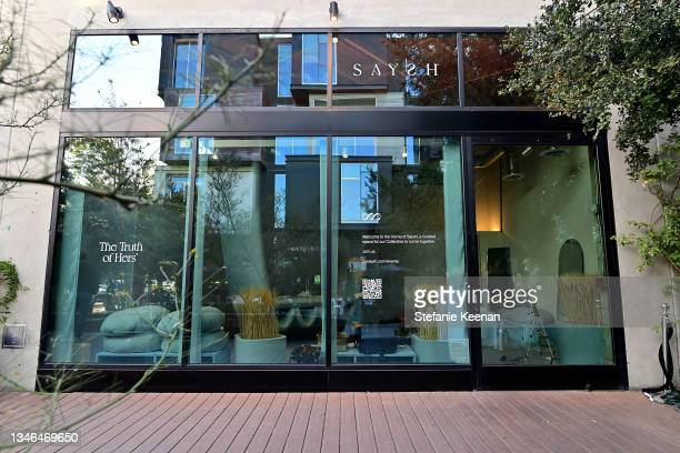 View of the exterior is seen during a work out led by Megan Roup from The Sculpt Society as Olympian Allyson Felix opens Saysh's new experiential...