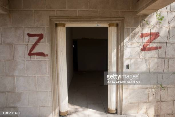 View of the exterior of an abandoned house painted by Los Zetas criminal group in China, Nuevo Leon State, Mexico, on November 22, 2019. - AFP has...