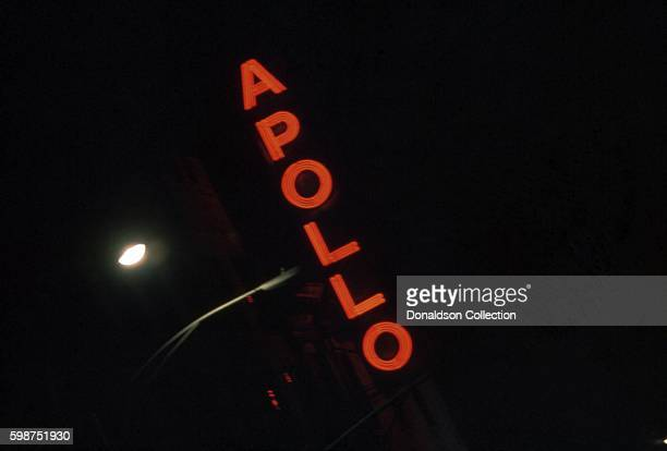 View of the exterior of the Apollo Theater in Harlem at night in 1976 in New York City, New York.