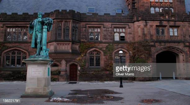 View of the facade of the East Pyne Building and a statue of Princeton University President John Witherspoon on the Pinceton University campus,...