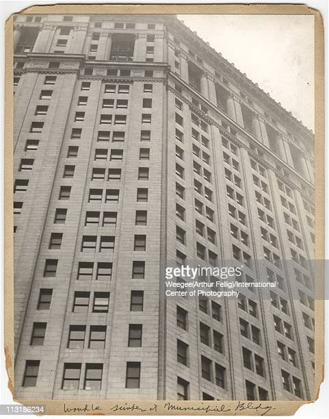 View of the facade of the Manhattan Municipal Building where a man looks to be about to jump New York New York twentieth century The image was...