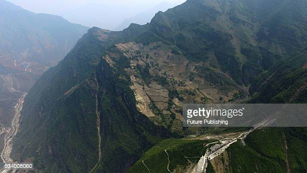 A view of the farm land and houses of Atule'er Village on the slope on top of a mountain in Zhaojue county in southwest China's Sichuan province on...