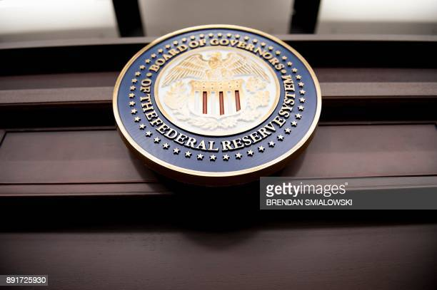 View of the Federal Reserve Board of Governors seal is pictured before a briefing at the US Federal Reserve December 13, 2017 in Washington, DC. -...