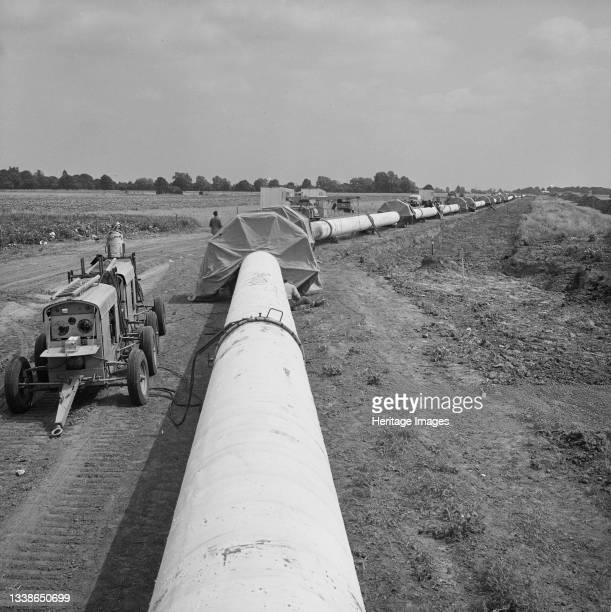 View of the Fens gas pipeline, showing protective canopies located at joints along the pipe where sub welds were carried out. Work on laying the Fens...