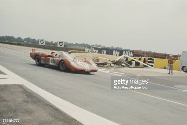 View of the Ferrari 512S Ferrari 50L V12 racing car driven by American drivers Ronnie Bucknum and Sam Posey for North American Racing Team to finish...