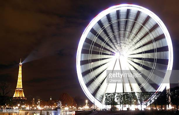 A view of the Ferris wheel at 'Place de la Concorde' and the Eiffel Tower on November 13 2015 in Paris France Paris will host the World Climate...