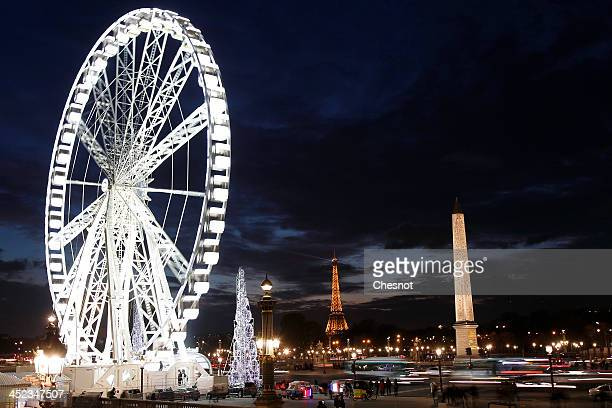 """View of the Ferris wheel at """"Place de la Concorde"""" during Christmas illuminations on November 27, 2013 in Paris, France. The 65-meter high Ferris..."""