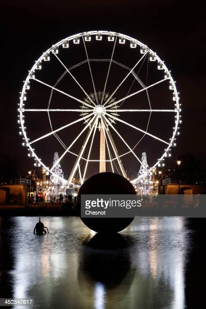 A view of the Ferris wheel at Place de la Concorde during Christmas illuminations on November 27 2013 in Paris France The 65meter high Ferris Wheel...