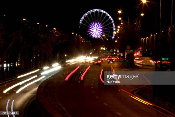 View of the ferris wheel at 'Place de la Concorde' next to ChampsElysees at night during Christmas illuminations in Paris France on November 24 2017