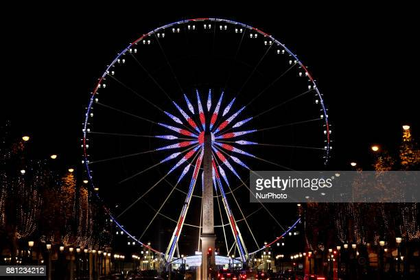 View of the ferris wheel at 'Place de la Concorde' next to ChampsElysees at night during Christmas illuminations in Paris France on November 25 2017