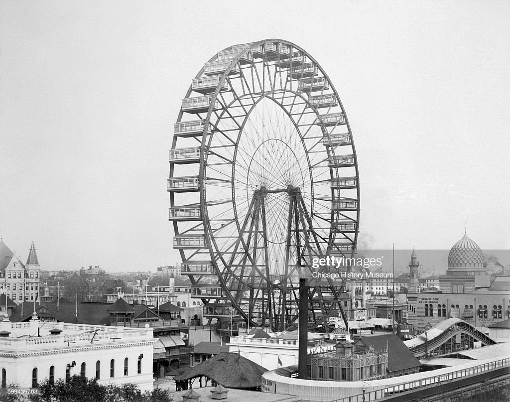 View of the Ferris wheel on the Midway Plaisance at the World's Columbian Exposition world's fair, Chicago, Illinois, 1893.
