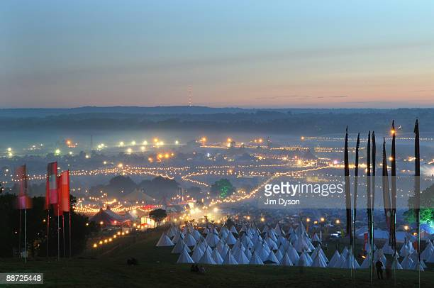 A view of the festival site from Pennard Hill at dawn during day 4 of the Glastonbury Festival at Worthy Farm in Pilton Somerset on June 28 2009 in...
