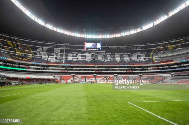 View of the field and the empty stands before the Mexican Clausura tournament football match between America against Cruz Azul at Azteca Stadium, in...