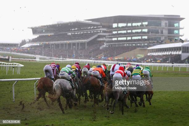A view of the field as it enters the home straight in the Randox Health County Handicap Hurdle at the Cheltenham Festival at Cheltenham Racecourse on...