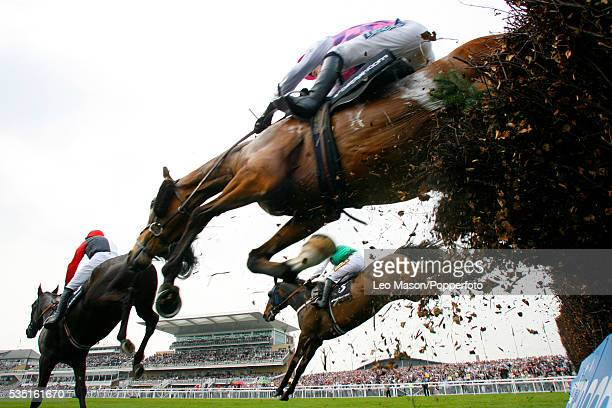 View of the field clearing the third fence during the Betfair Bowl Chase at the Grand National meeting at Aintree Racecourse near Liverpool on 12th...