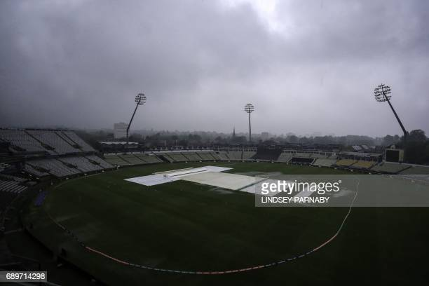 A view of the field covers protecting the grass from the heavy rain as play is abandoned for the day in the ICC Champions Trophy Warmup cricket match...