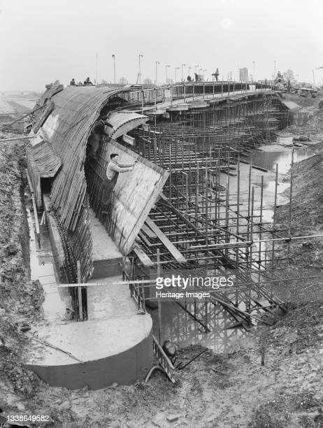 View of the final steelfixing being carried out on the internal haunch inclined shutters and curved internal haunch shutters of Structure 63, a...
