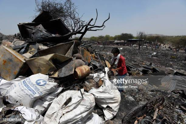 A view of the fire site in which around 1000 shanties burnt down and turned into ashes on Monday night at Tughlakabad Extension on May 26 2020 in New...