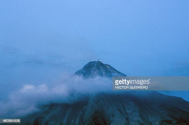 View of the Fire Volcano spewing ashes from San Antonio community Colima State Mexico on January 1 2015 The Fire Volcano is one of the most active in...