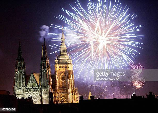 View of the fireworks over St Vitus cathedral 01 May 2004 in Prague as thousands of Czechs celebrate with music festivals and fireworks their entry...