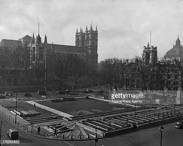A view of the first stages of the stands being assembled in Parliament Square in preparation for the Coronation London 17th March 1953 Westminster...