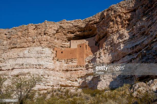 View of the five story cliff dwelling high above Beaver Creek built and used by the Sinagua people around 1100 AD at the Montezuma Castle National...