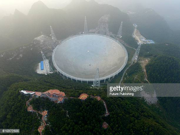 A view of the Fivehundredmeter Aperture Spherical radio Telescope in Pingtang county on September 25 2016 in Guizhou China The project boasting of...